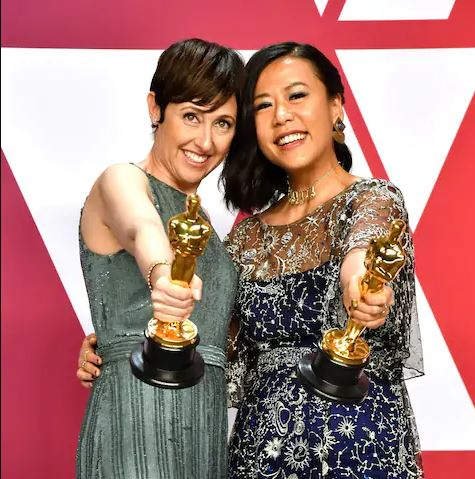 Best Animated Short Film winners for 'Bao' Domee Shi and Becky Neiman-Cobb. Credit: Jeff Kravitz/Filmmagic